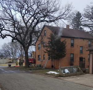Smoke pours from second floor of Marinos apartment house