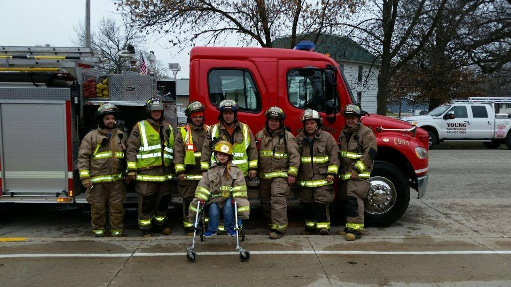 Michael Young with the firemen (Facebook photo)