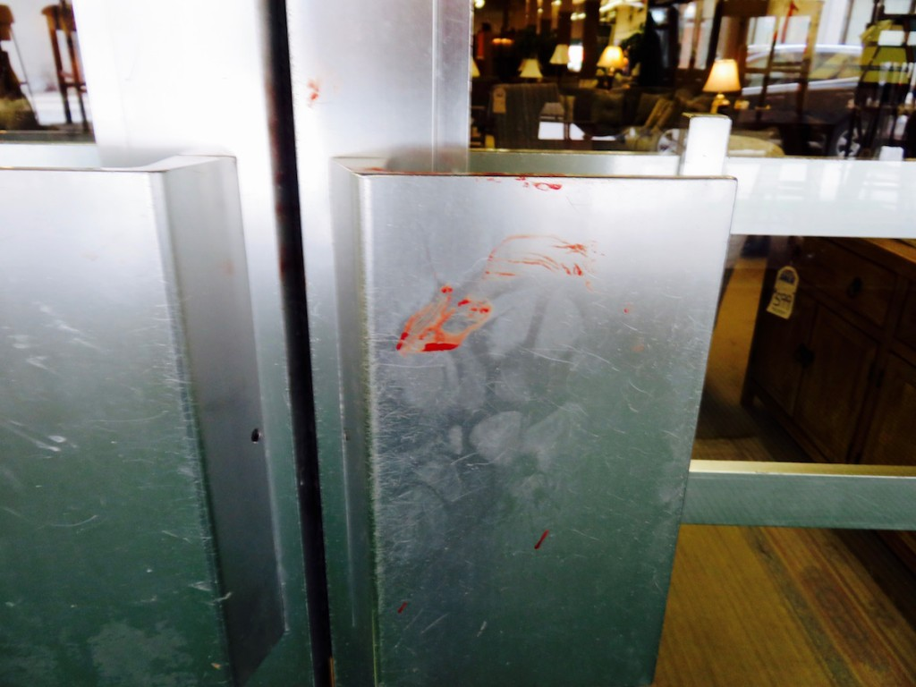 Blood on the main door after the accident