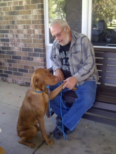 Lynn Berding with his (former) dog, Jack, who was brought to PAWS and then given away