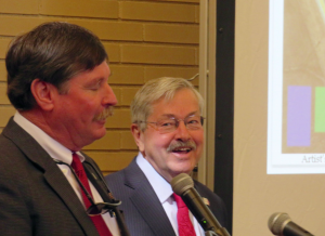 Dr. Ron Prestage with Governor Terry Branstad on March 21, when a whole lot of congratulatory backslaps where handed out in the Historic Park Inn Hotel ballroom over this development that never came to be.