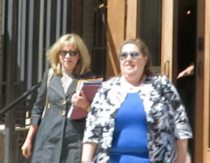 """Robin Anderson and her protege, Julie Valencia formerly of Kaplan University, leave the """"meeting""""."""