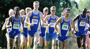 Photo of the NIACC men's cross country team at the start of the Les Duke Invitational on Sept. 10 in Grinnell.