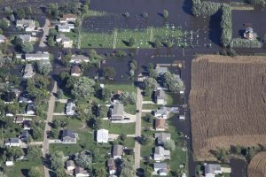 An aerial view from a UH-60 Blackhawk helicopter shows flooding around Cedar Rapids, Iowa, Sept. 26, 2016, following heavy rains that forced thousands of residents from their homes. Members of the Iowa National Guard flew officials around the area to help determine how to proceed. Iowa National Guard photo by Air Force Tech. Sgt. Linda K. Burger