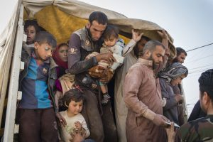 Internally displaced persons flee to Debaga camp in Erbil Governorate, northern Iraq, as Mosul assault begins. Photo: UNHCR/Ivor Prickett